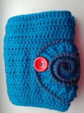 pochette au crochet avec une -ammonite pour la fermeture